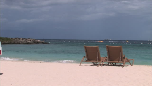 cebu sea beach sea and two deckchairs placed side by side on the sand beach - deckchair stock videos & royalty-free footage