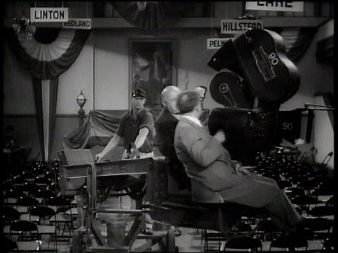Cecil B DeMille riding camera crane gesturing / Hollywood California United States
