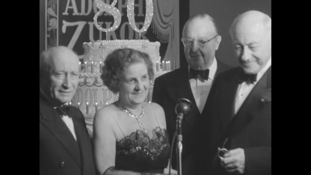 cecil b demille shakes hands with lottie zukor as adolph zukor founder of paramount pictures and jesse lasky look on / zukor lottie jesse demille / y... - cecil b. demille stock videos & royalty-free footage