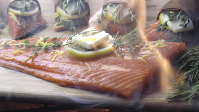 cedar plank salmon with lemon and herbs - plank stock videos & royalty-free footage