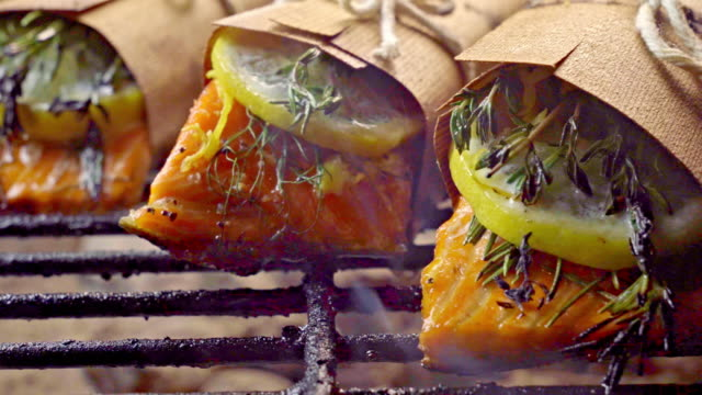 cedar plank salmon with lemon and herbs - low carb diet stock videos & royalty-free footage
