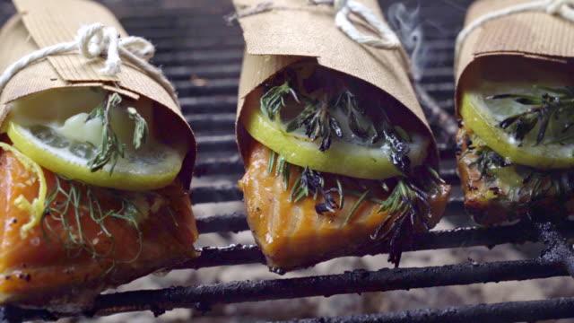cedar plank salmon with lemon and herbs - cedar stock videos & royalty-free footage
