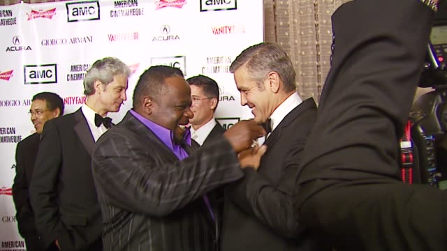 cedric the entertainer and george clooney at the 2006 annual american cinematheque awards honoring george clooney at the beverly hilton in beverly... - american cinematheque stock-videos und b-roll-filmmaterial