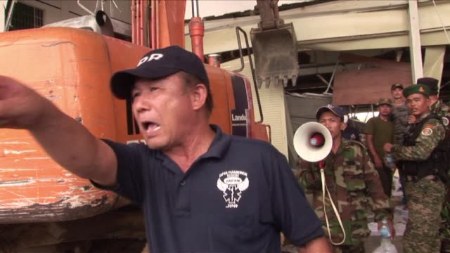 ceiling collapse at a cambodian shoe factory killed two workers thursday spurring a government vow to inspect all garment plants amid heightened... - garment stock videos & royalty-free footage