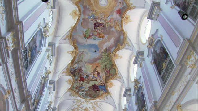 la td ws ceiling covered with frescos by johann baptist zimmermann and interior of st. peter's church, munich, bavaria, germany - baroque stock videos & royalty-free footage