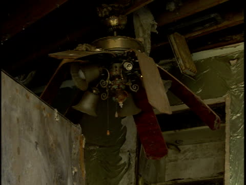 Ceiling fan videos and b roll footage getty images dv ceiling fan hanging from beam w blades bent down broken ceiling rafter wooden beams aloadofball Gallery