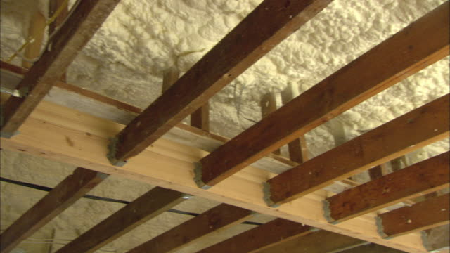 cu la pan ceiling of home under construction where insulation has just been blown in and is exposed / portland, oregon, usa - roof beam stock videos & royalty-free footage