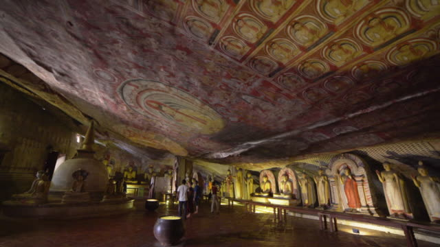 ceiling paintings at dambulla cave buddhist gold temple indoors, sri lanka - sri lanka stock videos & royalty-free footage