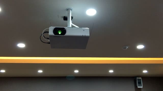 ceiling projector in the meeting room. - projection equipment stock videos & royalty-free footage