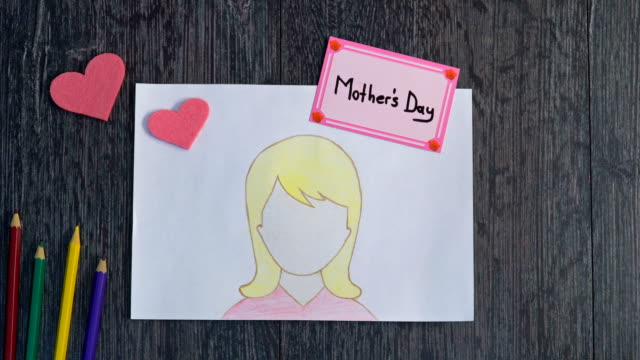 4k celebrates mother's day with drawing picture - mother's day stock videos & royalty-free footage