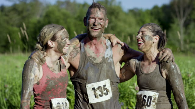 celebrating a good race - mud stock videos & royalty-free footage