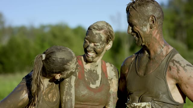 celebrating after mud run - survival stock videos and b-roll footage
