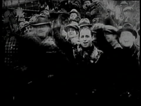 montage celebrating in the streets that the strike has ended / detroit michigan united states - 1937 stock videos and b-roll footage