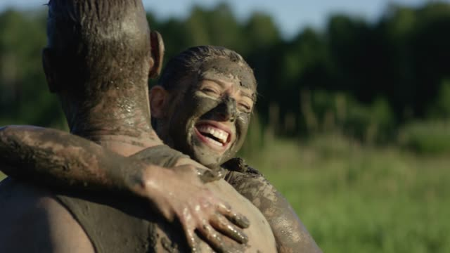 celebrating mud run finish - image stock videos & royalty-free footage