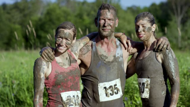 celebrating mud run finish - endurance stock videos & royalty-free footage