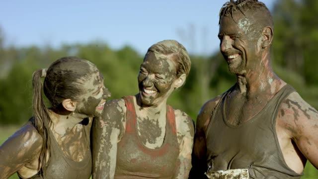 celebrating mud run finish - superwoman stock videos and b-roll footage