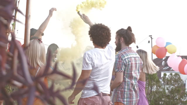 celebrating on a party with colorful smoke bombs - patio stock videos & royalty-free footage