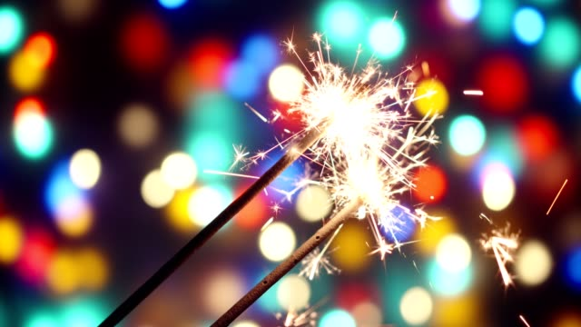 celebrating with sparklers - sparkler stock videos & royalty-free footage