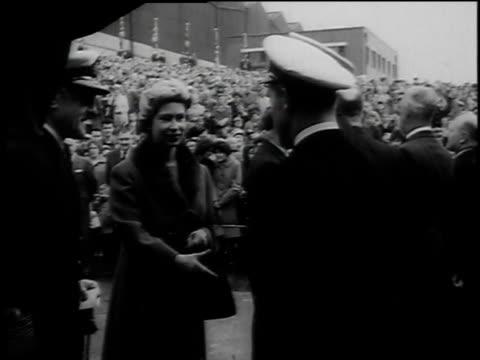 montage celebration as britain prepares to launch first nuclear submarine queen elizabeth is in attendance / united kingdom - stapellauf stock-videos und b-roll-filmmaterial