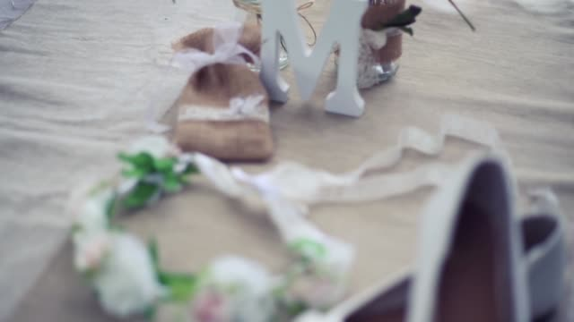 Celebration details with fabric bag, wooden letter, flowers and pennants