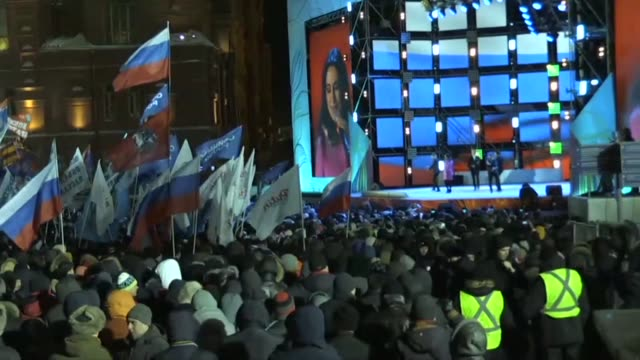 celebrations began on moscow's manezh square just outside red square on sunday night as projections showed vladimir putin on track to win a landslide... - vladimir russia stock videos and b-roll footage
