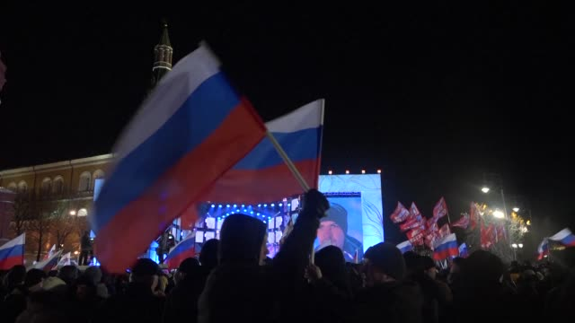 Celebrations began on Moscow's Manezh Square just outside Red Square on Sunday night as projections showed Vladimir Putin on track to win a landslide...
