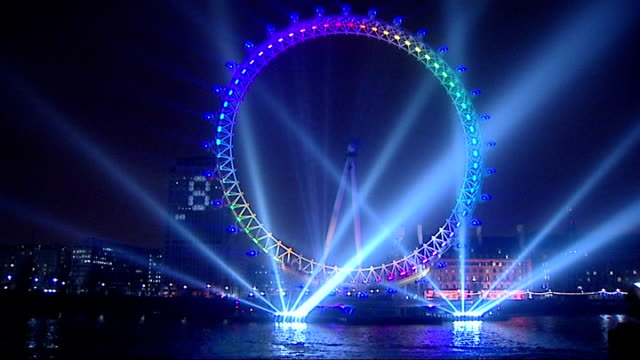 celebrations london england london ext london eye illuminated with spotlights and coloured lights before the huge firework display to welcome the new... - new stock videos and b-roll footage