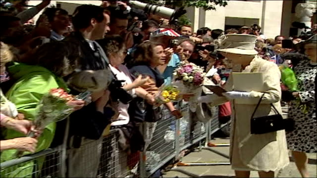 celebrations marking the queen's 80th birthday side view of queen elizabeth accepting cards and flowers from members of the public outside st paul's... - groucho marx stock videos & royalty-free footage