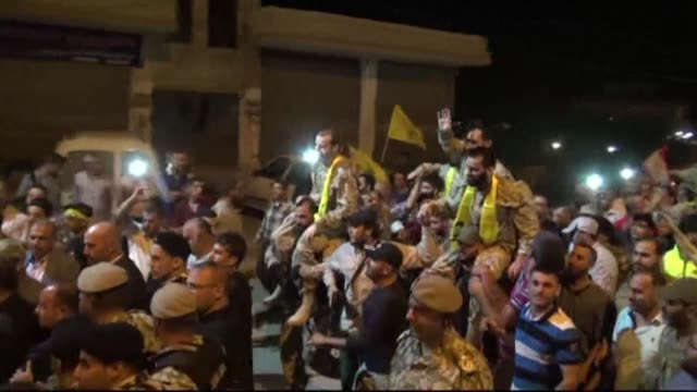 celebrations took place on thursday night in the lebanese town of al qaa near the border with syria where hundreds of people gathered to greet the... - hezbollah stock videos & royalty-free footage