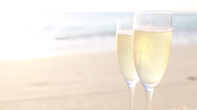 celebratory drink on the beach - champagne flute stock videos & royalty-free footage