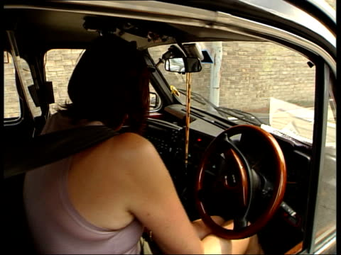 celebrities attending black taxi driver class / janet street porter driving cab black taxi cab as streetporter into driving seat of taxi / london... - janet street porter video stock e b–roll