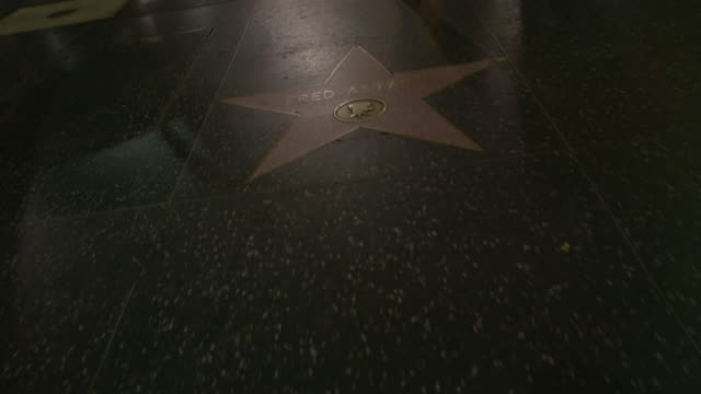 ms ha pov celebrities name on stars at the hollywood walk of fame / hollywood boulevard, hollywood, city of los angeles, california, united states - ウォークオブフェーム点の映像素材/bロール