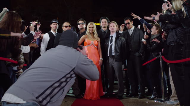 ms zi celebrities posing for photos amongst crowd at red carpet event / provo,utah,usa - provo stock videos & royalty-free footage