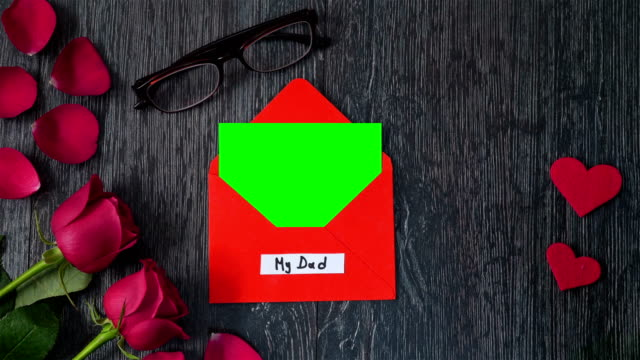 4k celebriting father's day with greeting card - father's day stock videos & royalty-free footage
