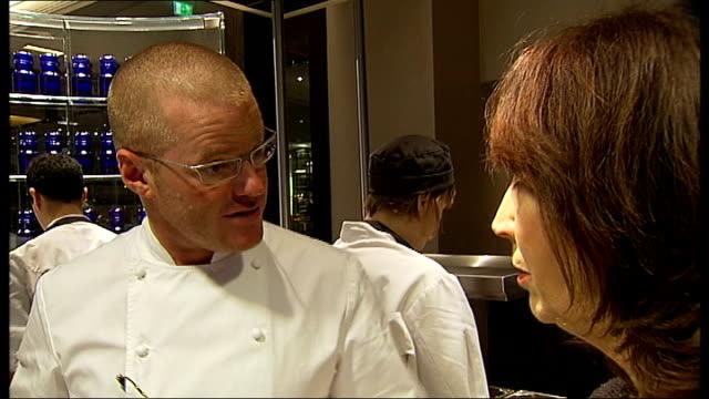Celebrity chef Heston Blumenthal opens new restaurant in London Heston Blumenthal listening as PalmerWatts describes plated food SOT Heston...