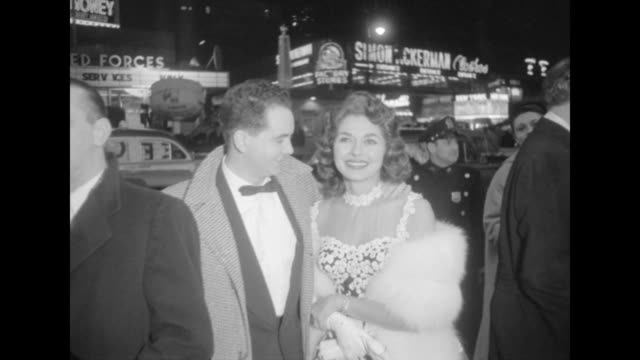Celebrity couple on sidewalk outside NYC movie premiere of The Eddie Cantor Story