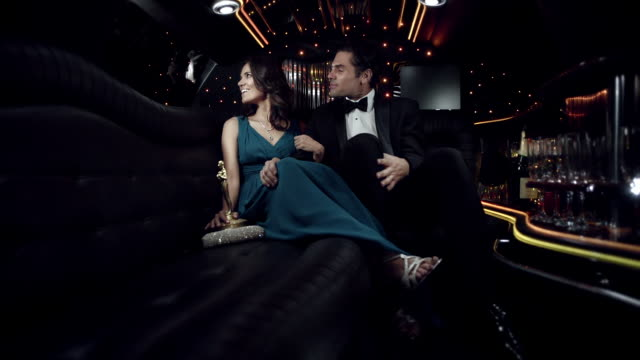 celebrity couple share moment in limousine as fans pound on window-panes at awards show - wife sharing stock-videos und b-roll-filmmaterial