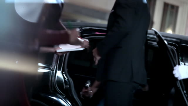 celebrity couple step out of limousine and sign autographs for fans on red carpet at awards show - collection stock videos & royalty-free footage