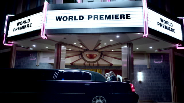 celebrity couple step out of limousine and walk red carpet under world premiere marquee at awards show - academy of motion picture arts and sciences stock videos and b-roll footage