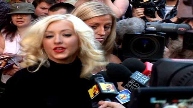 celebrity red carpet arrivals / interviews **beware christina aguilera speaking to press sot talks about new record really like to grow and challenge... - soul music stock videos & royalty-free footage