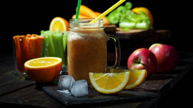 celery, carrot and orange smoothie - celery stock videos & royalty-free footage