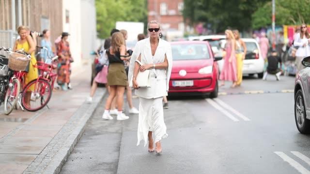 celine aagaard is seen outside stine goya during the copenhagen fashion week spring/summer 2019 on august 8 2018 in copenhagen denmark - spring summer collection stock videos & royalty-free footage