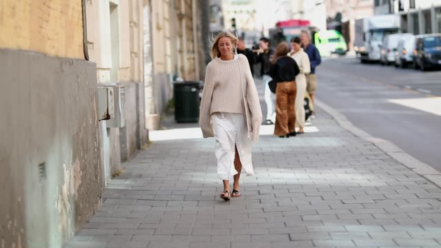 Celine Aagaard wearing white silk dress knit sandals is seen outside the Epilogue show during Oslo Runway SS19 on August 14 2018 in Oslo Norway