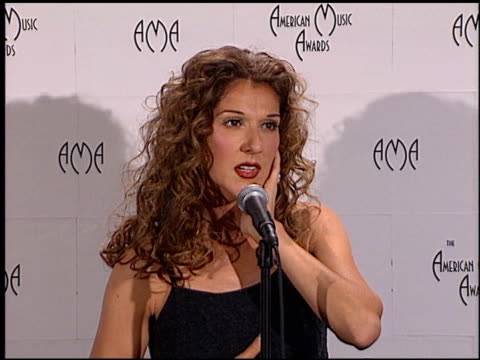vídeos de stock e filmes b-roll de celine dion at the 1999 american music awards press room at the shrine auditorium in los angeles california on january 11 1999 - 1999
