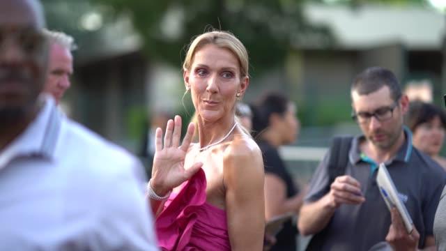 celine dion wears a pink ruffled dress, a necklace, earrings, outside miu miu club 2020, on june 29, 2019 in paris, france. - セリーヌ・ディオン点の映像素材/bロール