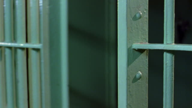 a cell door slams shut. - jail cell stock videos & royalty-free footage