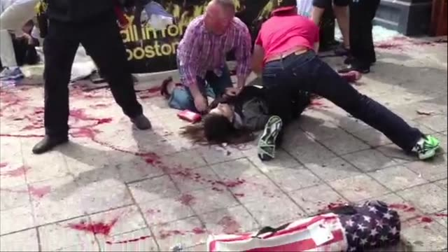 Cell phone footage shows the upclose mayhem after the Boston Marathon bomb blasts including multiple victims lying in pools of blood near the...