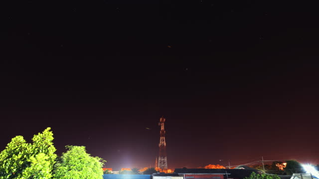 cell phone tower. communication tower in starry night. - electricity pylon stock videos and b-roll footage