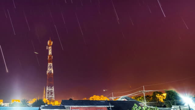cell phone tower. communication tower in starry night. - repeater tower stock videos and b-roll footage