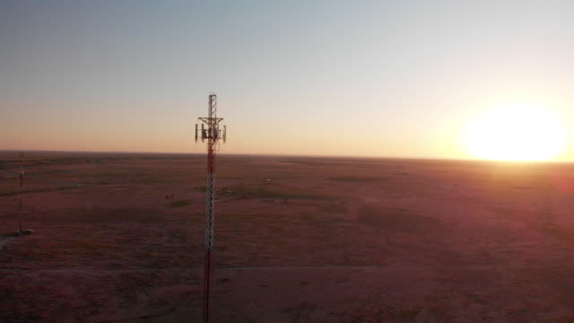 5g cell tower at sunset: cellular communications tower for mobile phone and video data transmission - tower stock videos & royalty-free footage